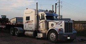 Truck and Boat, Heavy Haul Trucking, RGN Carrier, Load Transportation in Cheyenne, WY